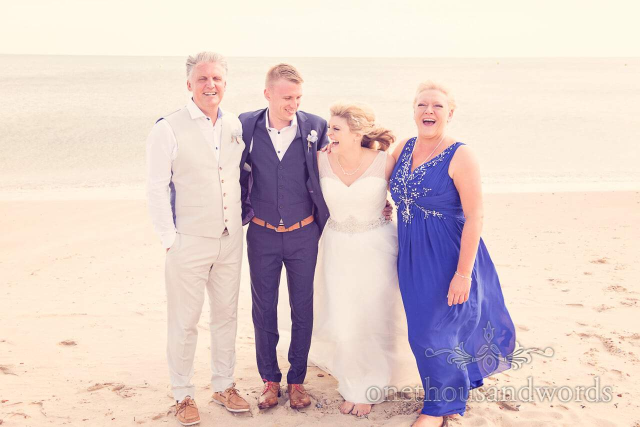 wedding group photograph on Sandbanks Beach in Dorset