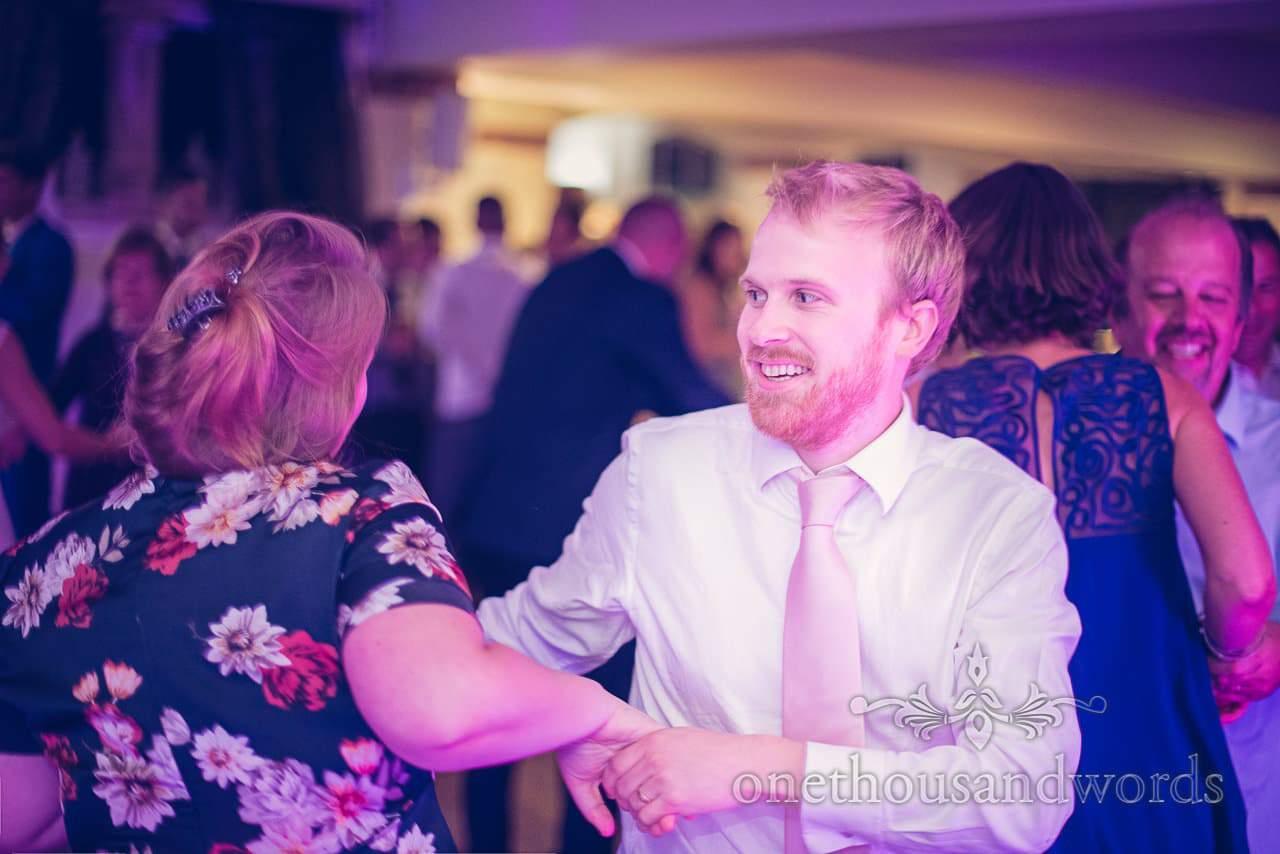 Wedding guest dances at Italian Villa wedding barn dance