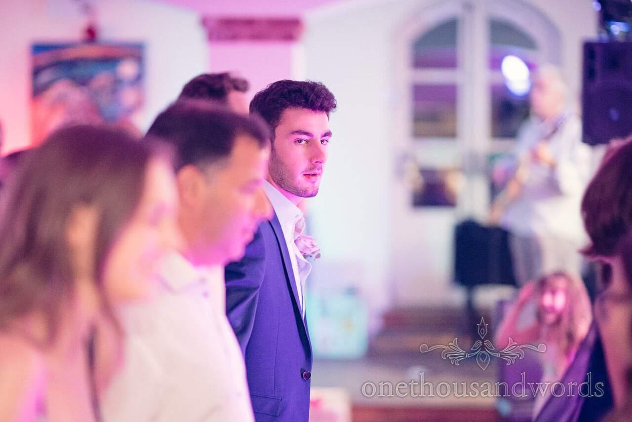 Wedding guest dancing at barn dance at italian villa wedding