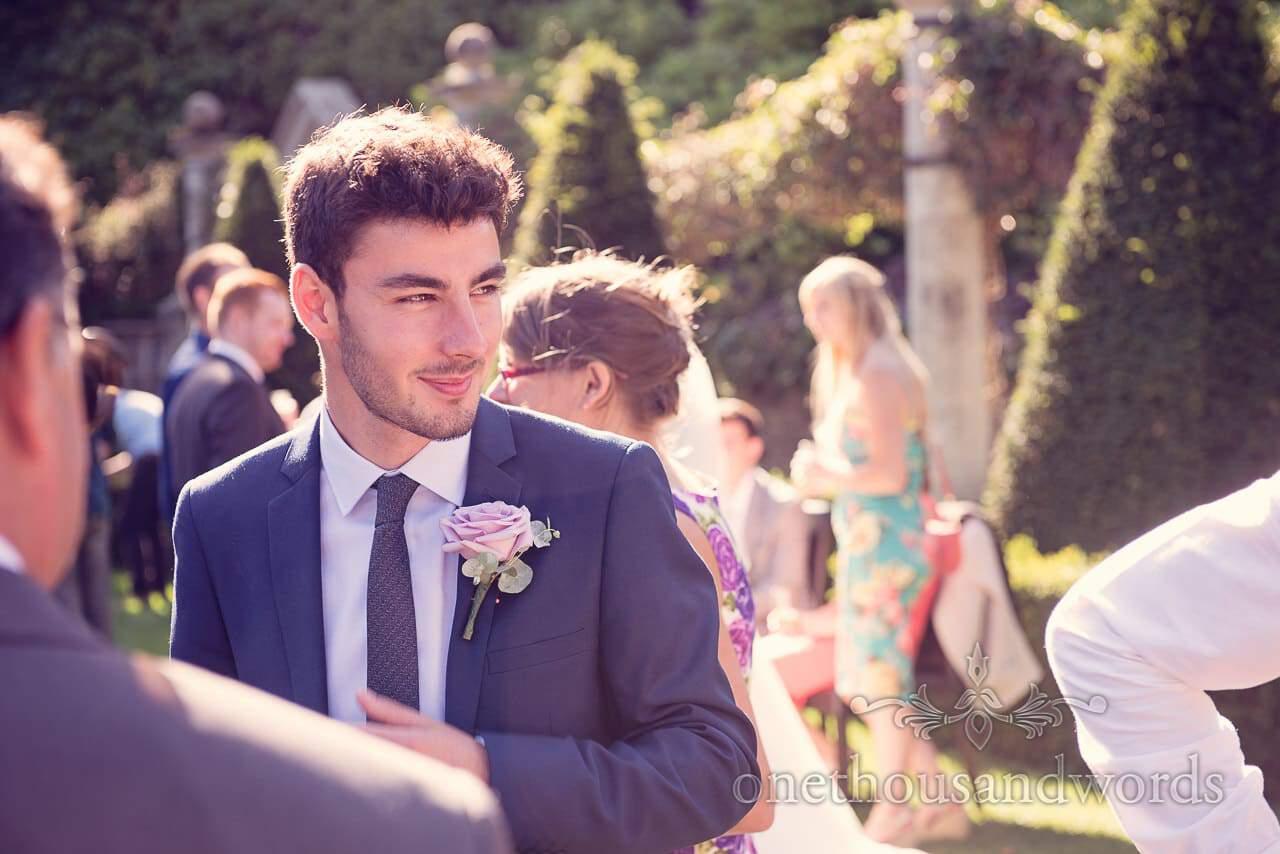 wedding guest enjoying sunshine in the gardens at italian villa wedding photographs