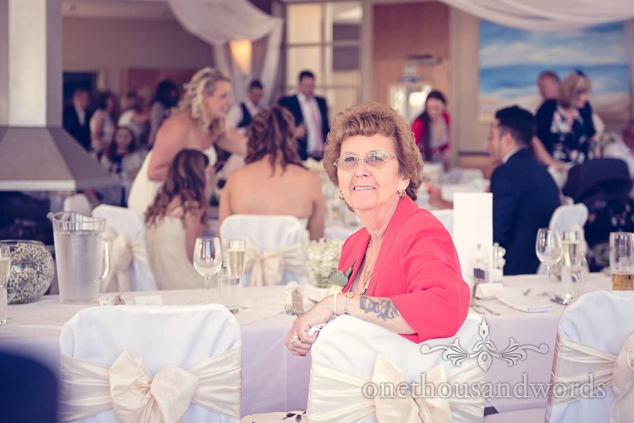 Wedding guest enjoys the sea view at Sandbanks Hotel Wedding