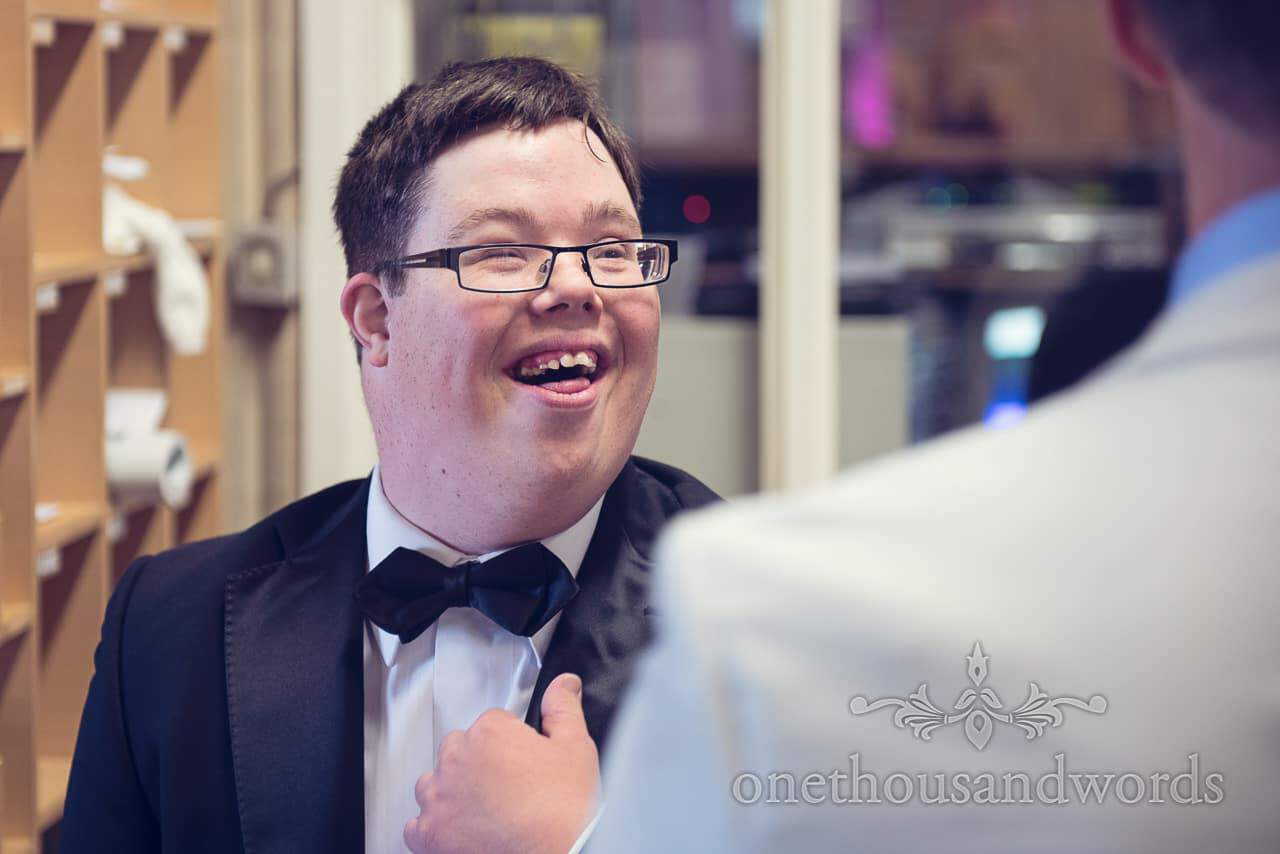 wedding guest in bow tie at St Marys Longfleet church wedding in Poole