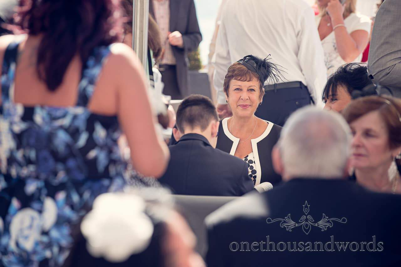 Wedding guest portrait photograph with fascinator at Sandbanks Hotel Wedding