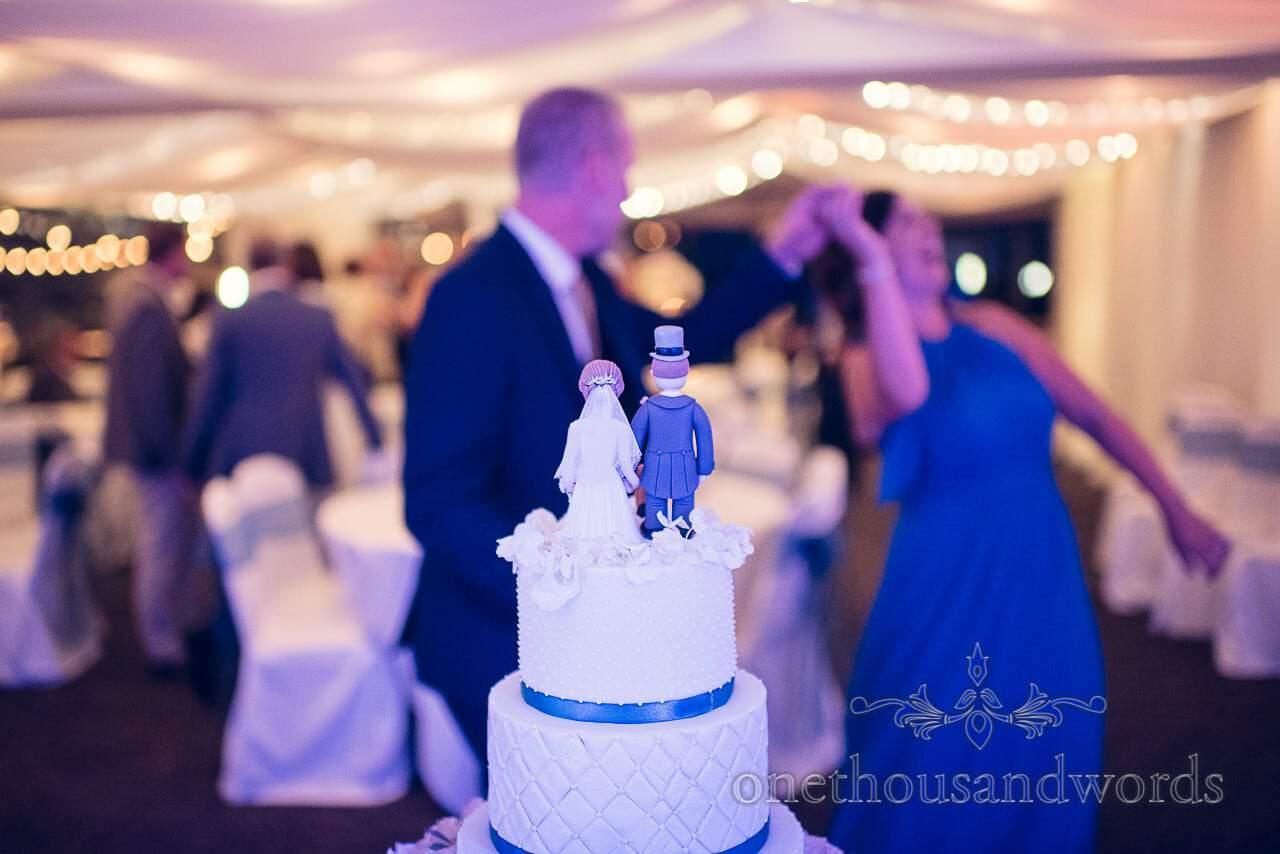 Wedding guests dance around wedding cake at harbour heights wedding photographs