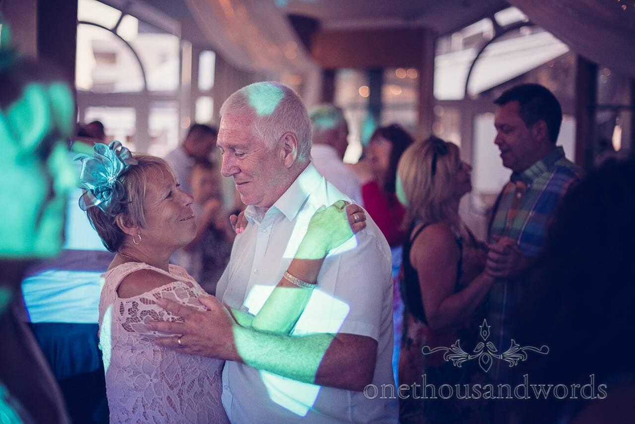Wedding guests dancing to wedding DJ at Sandbanks Hotel Wedding