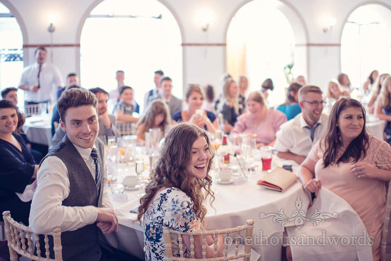Wedding guests laugh at speeches at italian villa wedding photographs