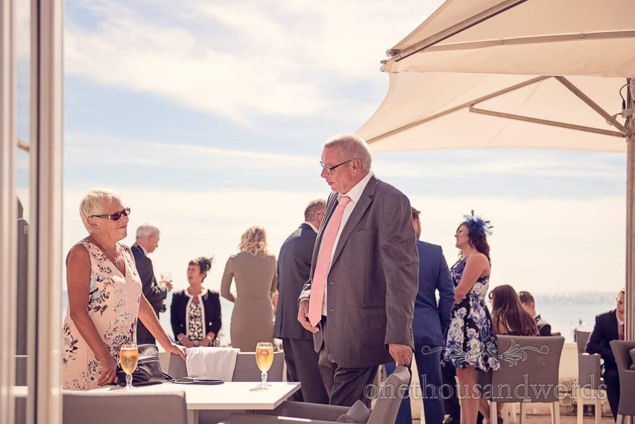 Wedding guests on sun terrace at Sandbanks Hotel Wedding