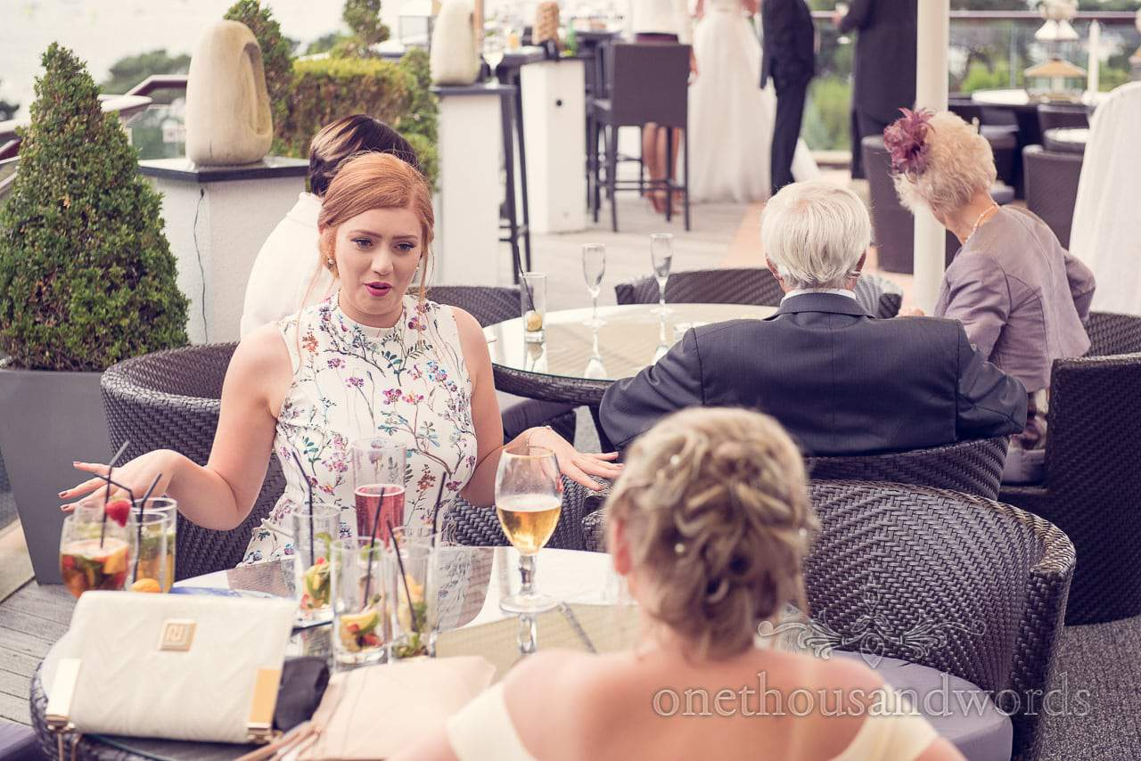 Wedding guests relax on sun terrace at Harbour Heights wedding photographs