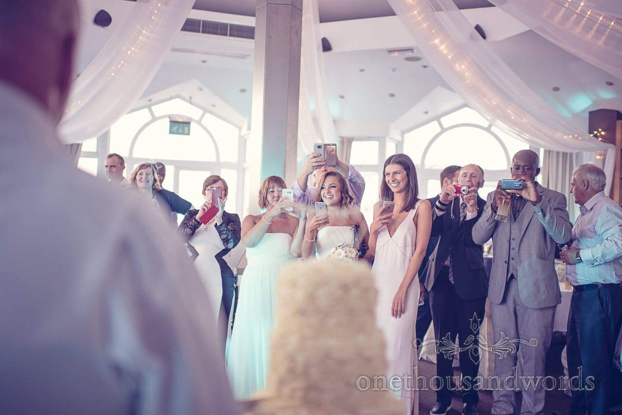 Wedding guests watch first dance with cameras and phones at Sandbanks Hotel