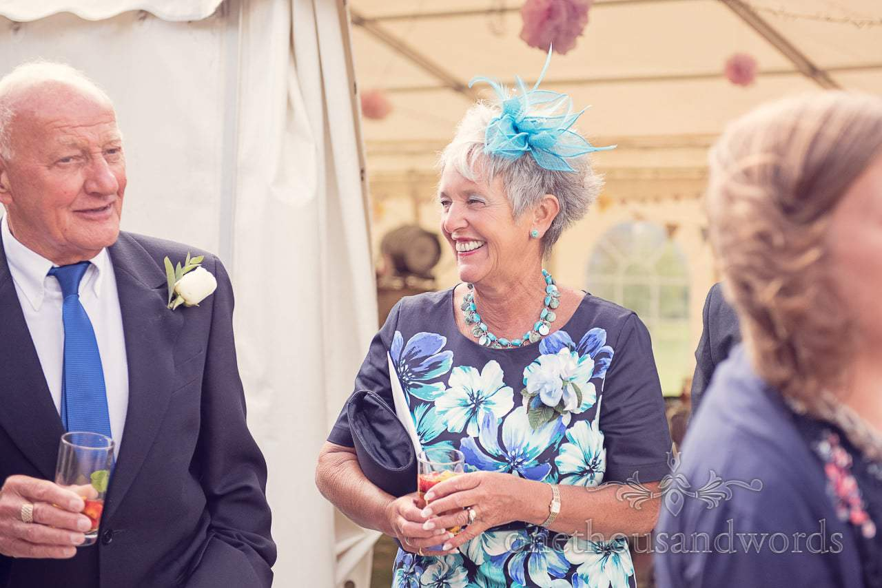 Wedding guests with matching blue outfits at Harmans Cross Wedding