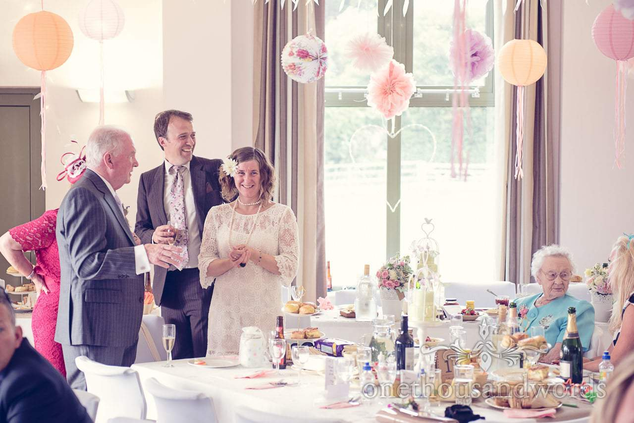 Wedding guests with paper pompoms and chinese lanterns at Harmans Cross Wedding