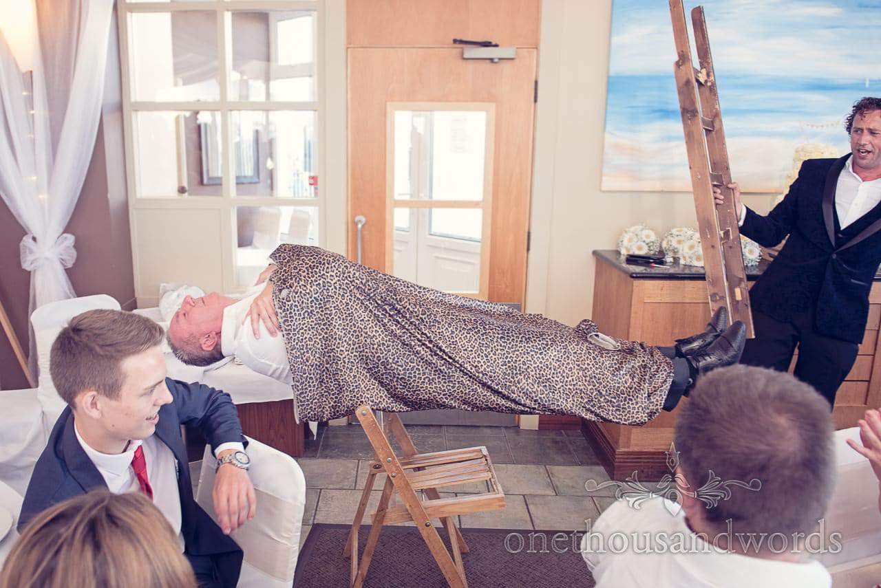 Wedding magician levitation trick with Sean Haydon at Sandbanks Hotel Wedding