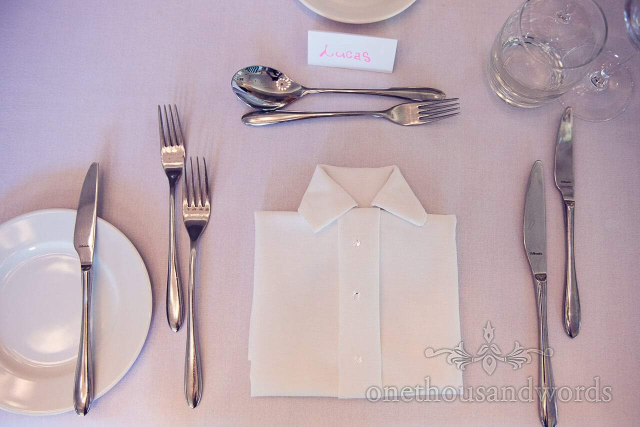 Wedding napkin folded to look like shirt with diamante buttons at Italian Villa wedding