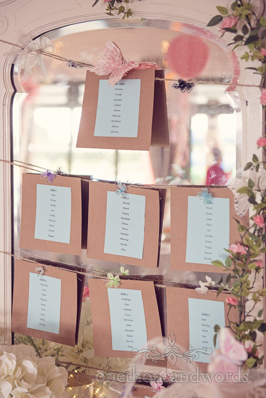 Wedding table plan with butterflies and mirror at Harmans Cross Wedding