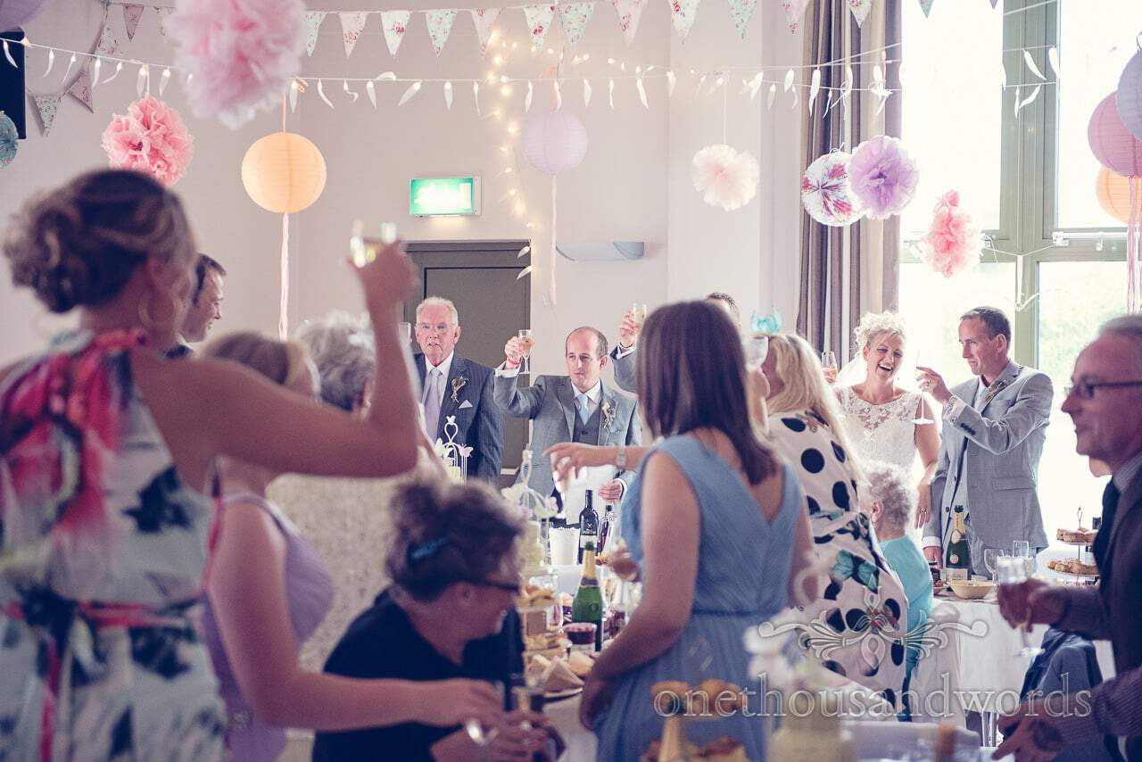 Wedding toasts at Harmans Cross Village Hall Wedding in Dorset