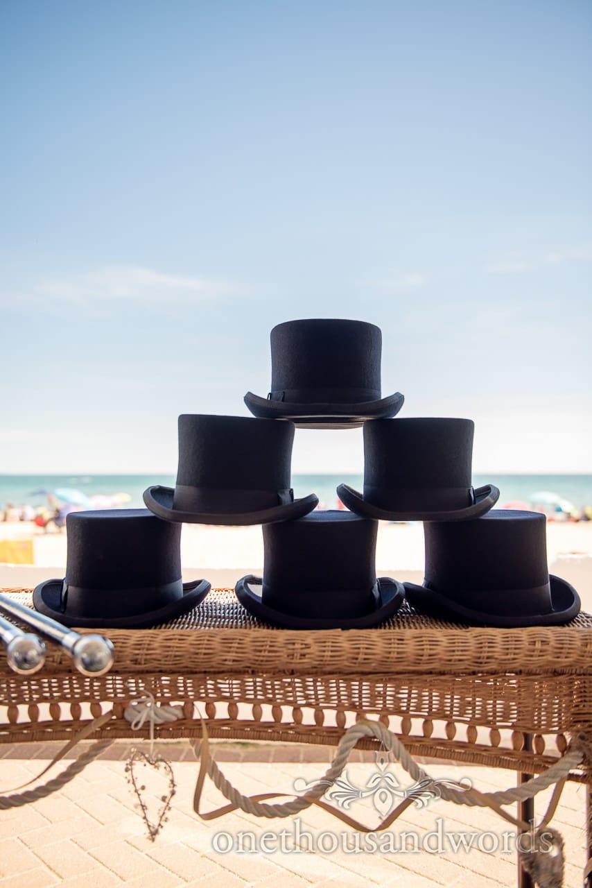 Wedding top hats with beach and sea at Sandbanks Hotel Wedding