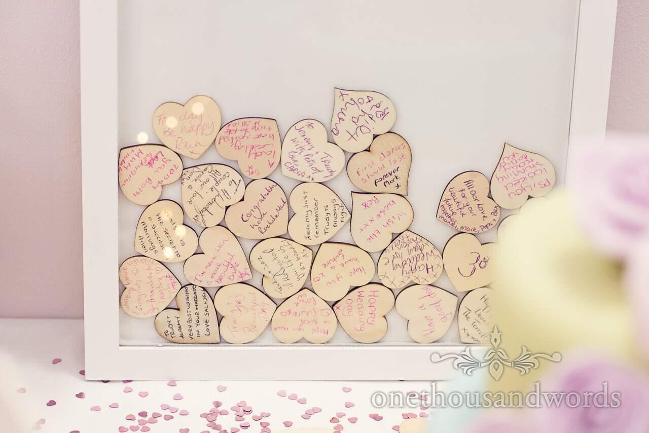 Wooden heart wedding message board at Harmans Cross Wedding
