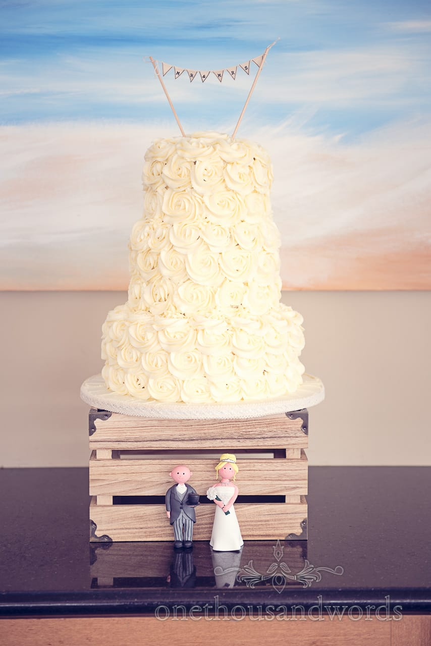 Yellow three tiered cake at Sandbanks Hotel Wedding