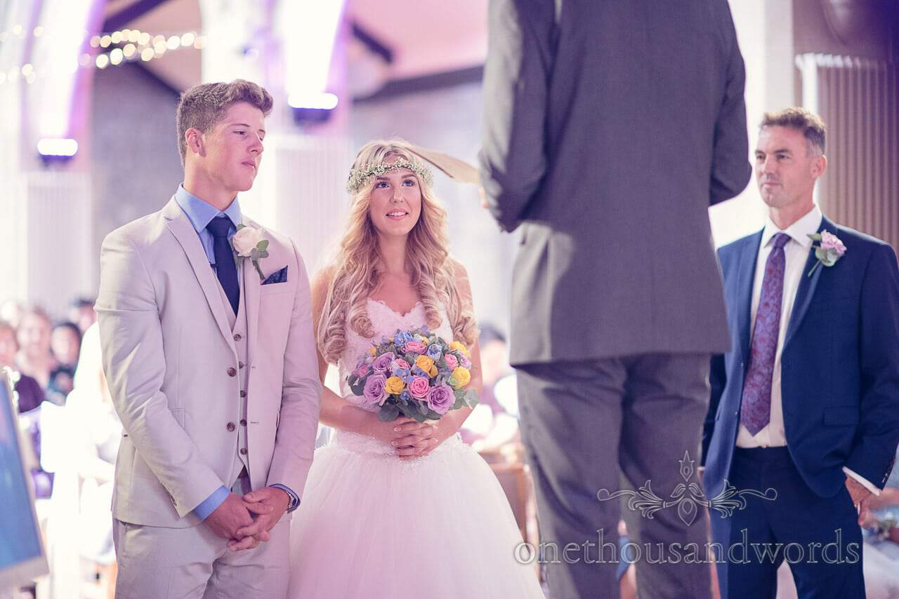 Young bride and groom during christian wedding ceremony at St Marys church Poole