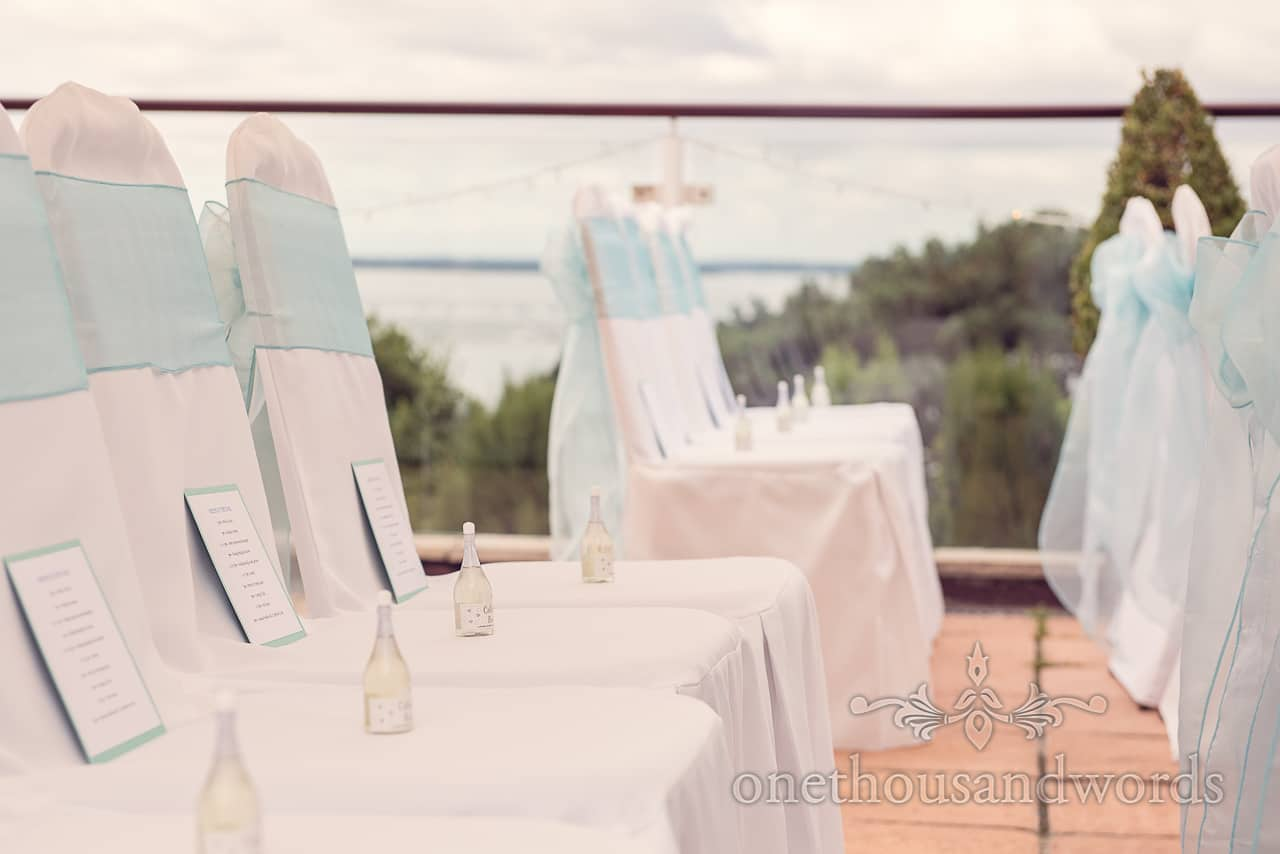 Aqua chair sashes and wedding bubbles at Harbour Heights Hotel outdoor wedding