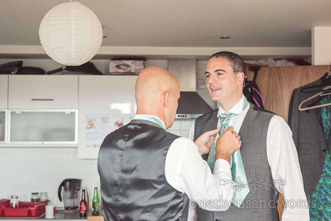 Best man helps groom with cravat before Harbour Heights wedding