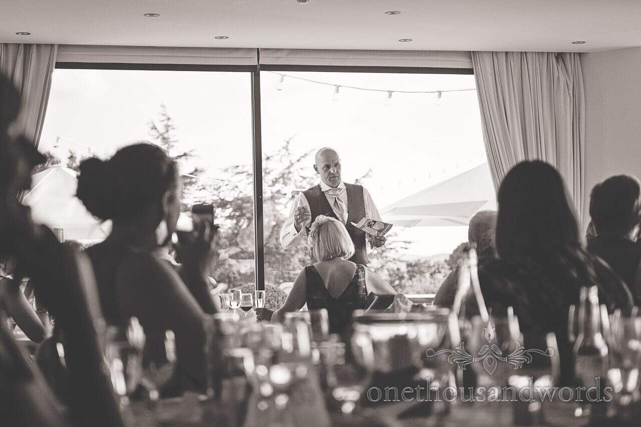 Black and white photograph from best mans speech at Harbour Heights wedding