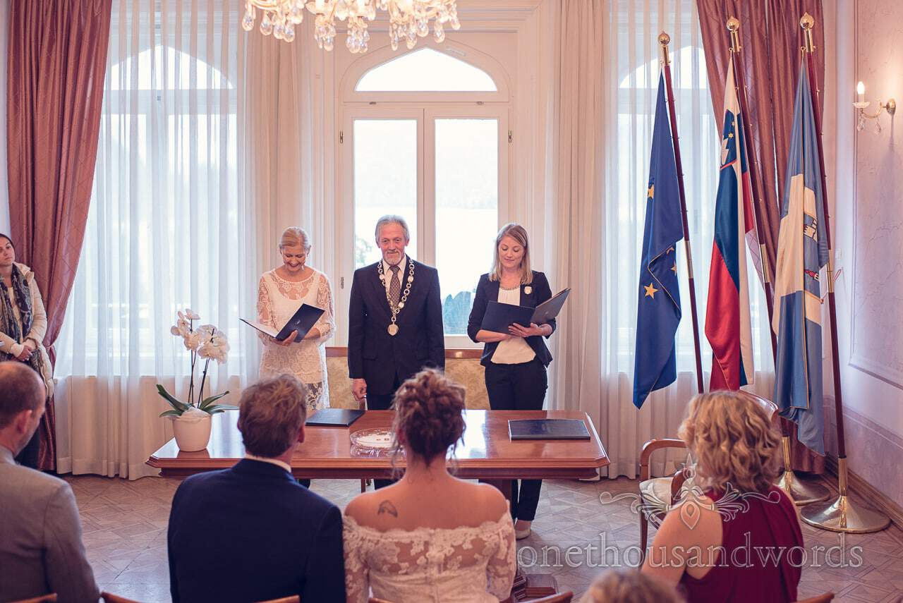 Bled Mayor and regisrar with flags at Bled Town Hall wedding ceremony in Slovenia