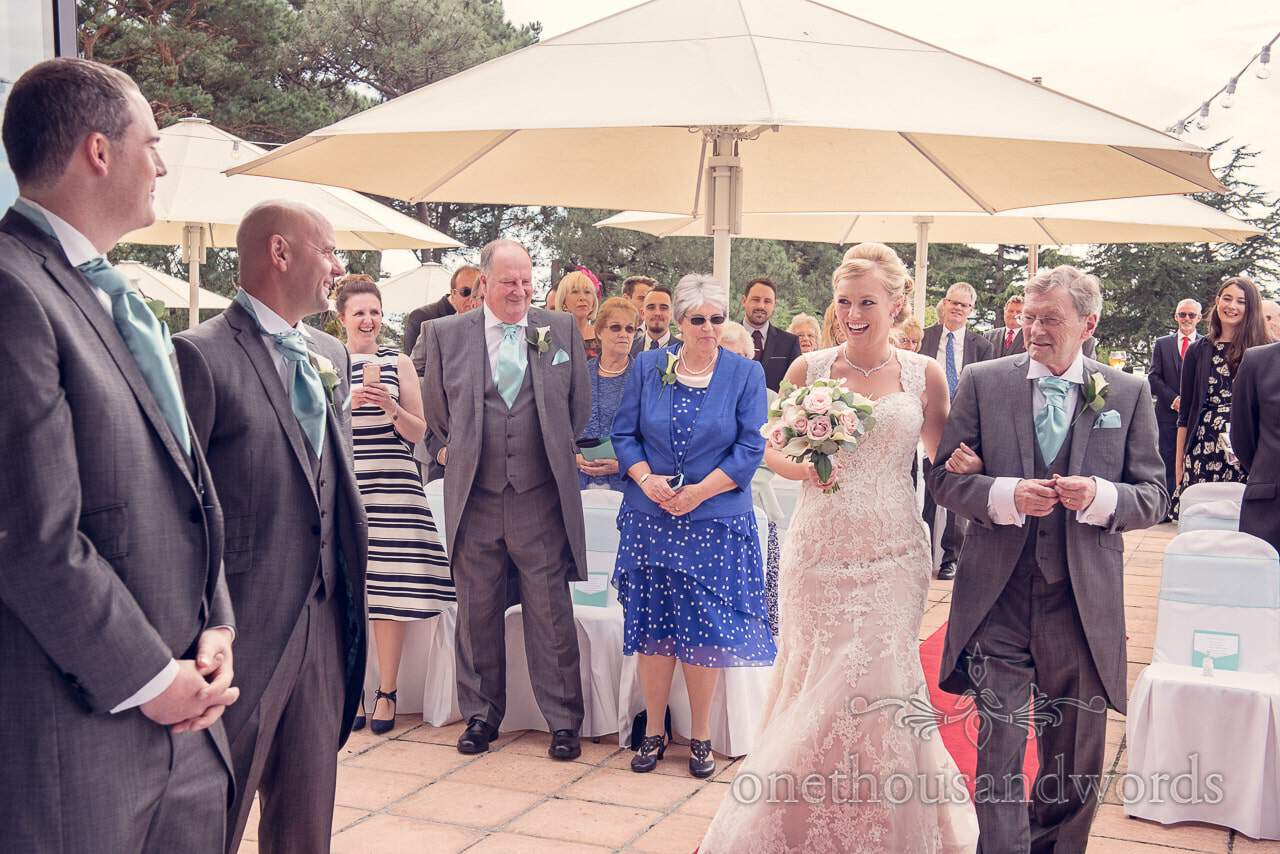 Bride and father at ceremony at Harbour Heights Hotel outdoor wedding