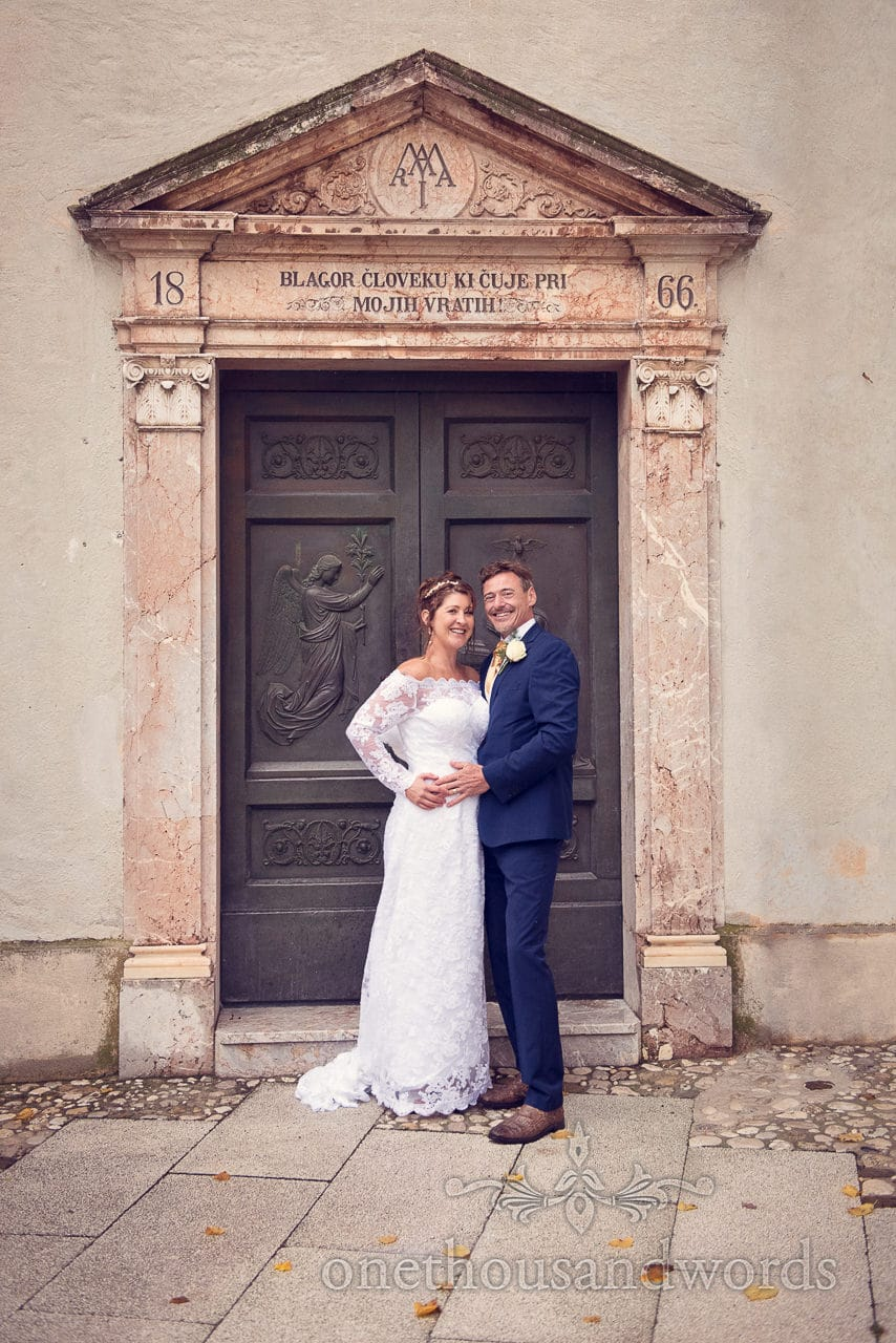 Bride and groom at Church of the Assumption of Mary, Lake Bled, Slovenia