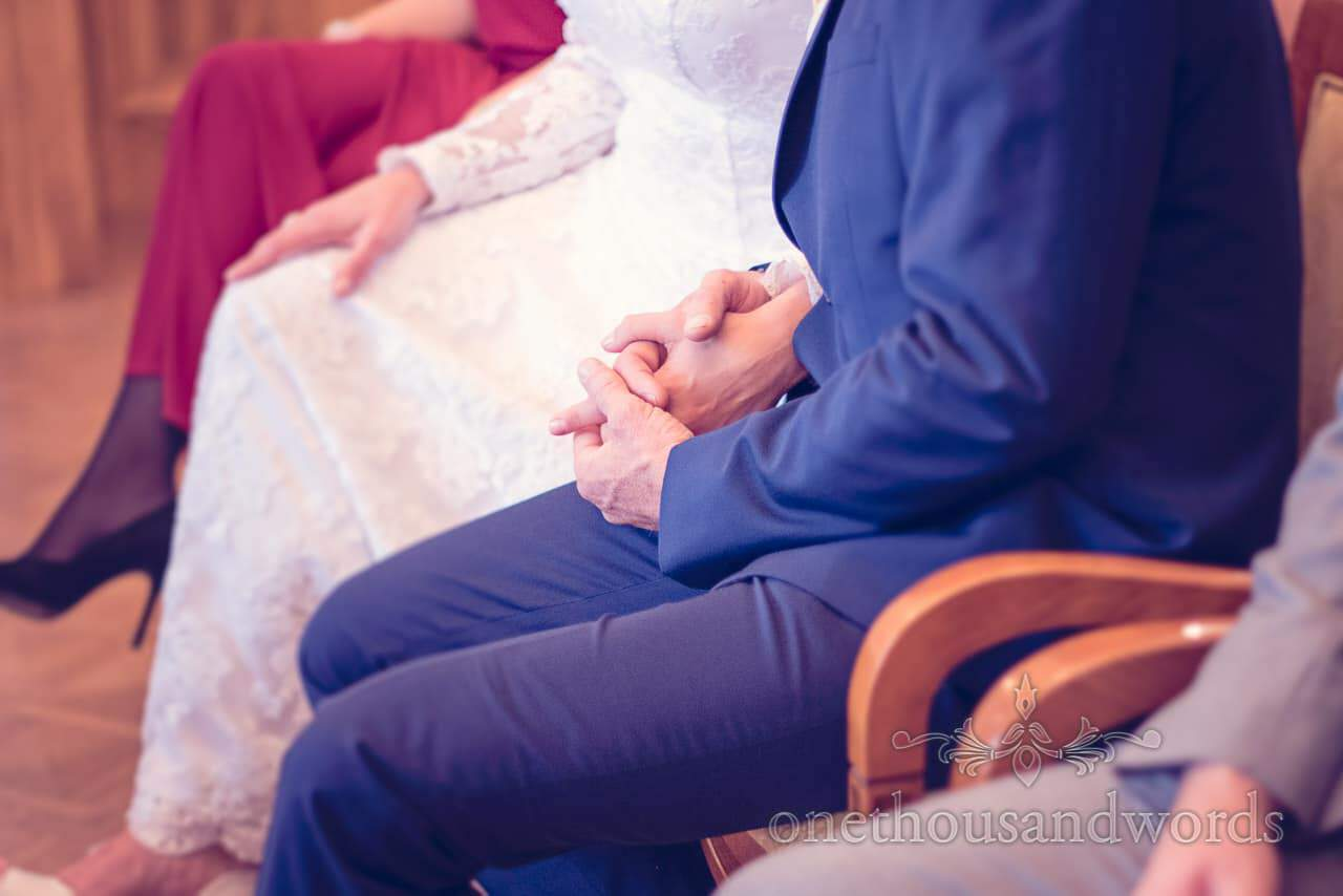 bride and groom hold hands during Bled Town Hall wedding ceremony in Slovenia