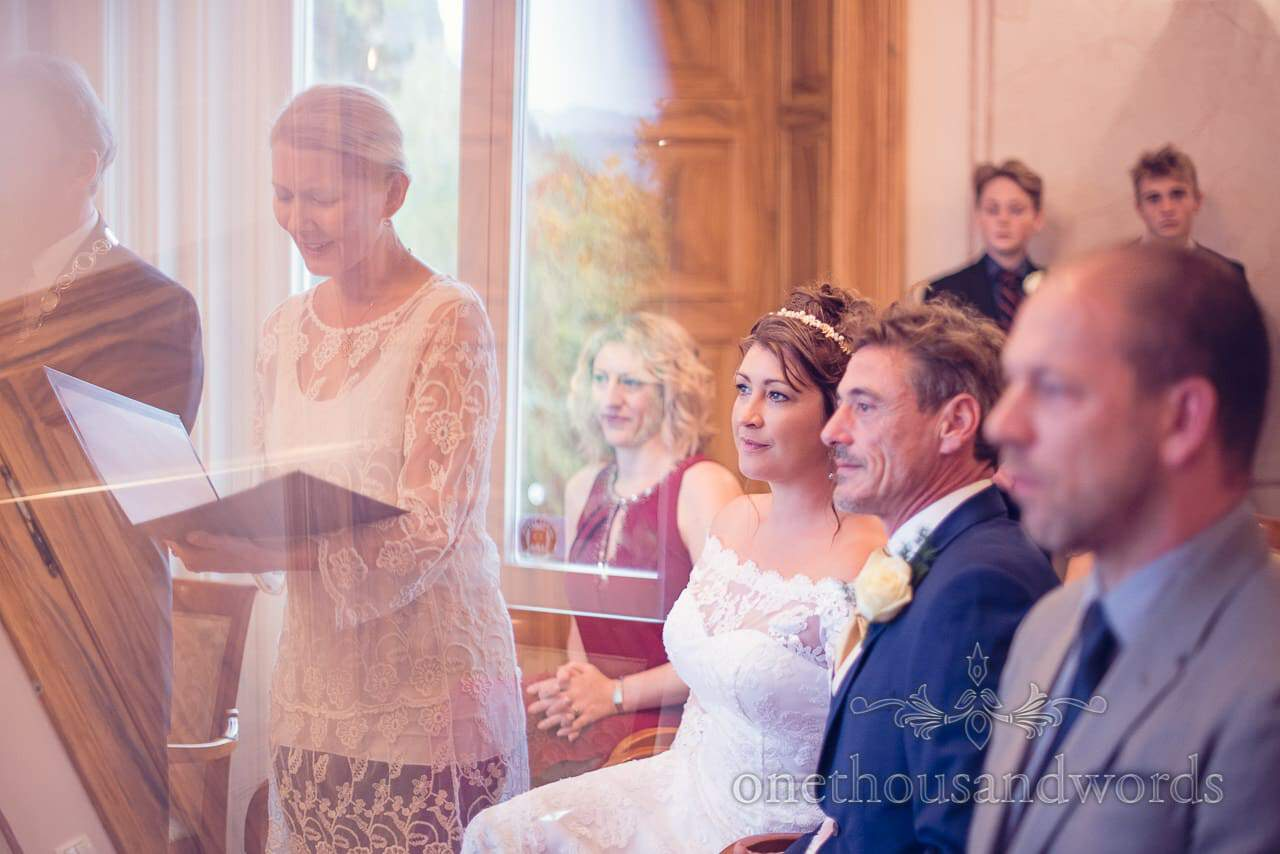 Bride and groom listen to translation of Slovenian wedding ceremony