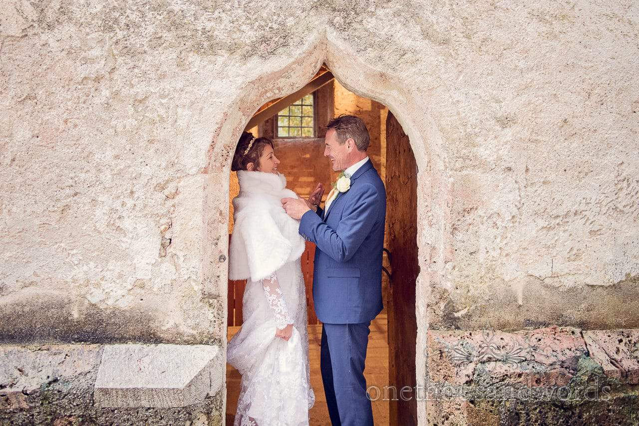 Bride and groom photograph in church doorway on Bled Island in Slovenia