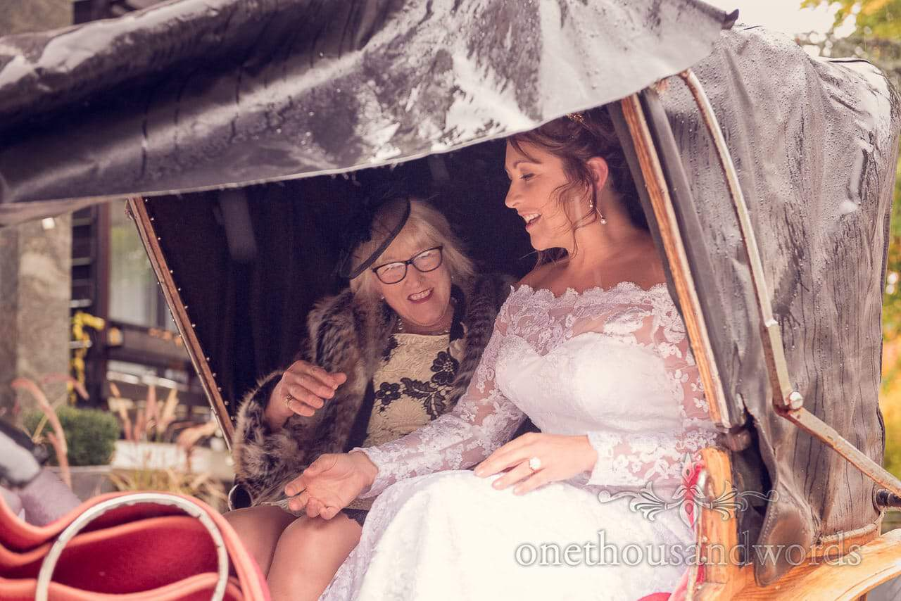 Bride and mother of the bride enter horse and carriage at Lake Bled wedding