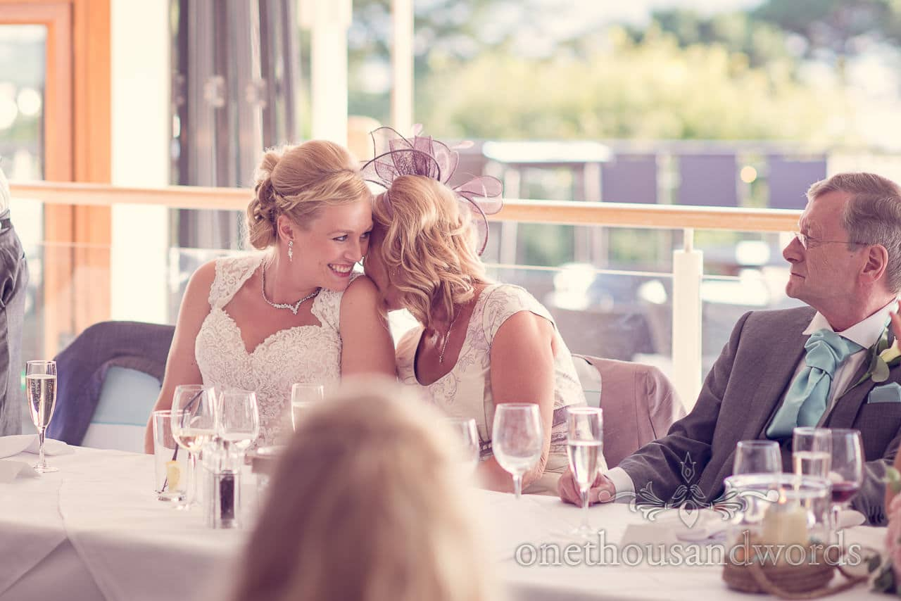 Bride and mother share a joke at Harbour Heights wedding