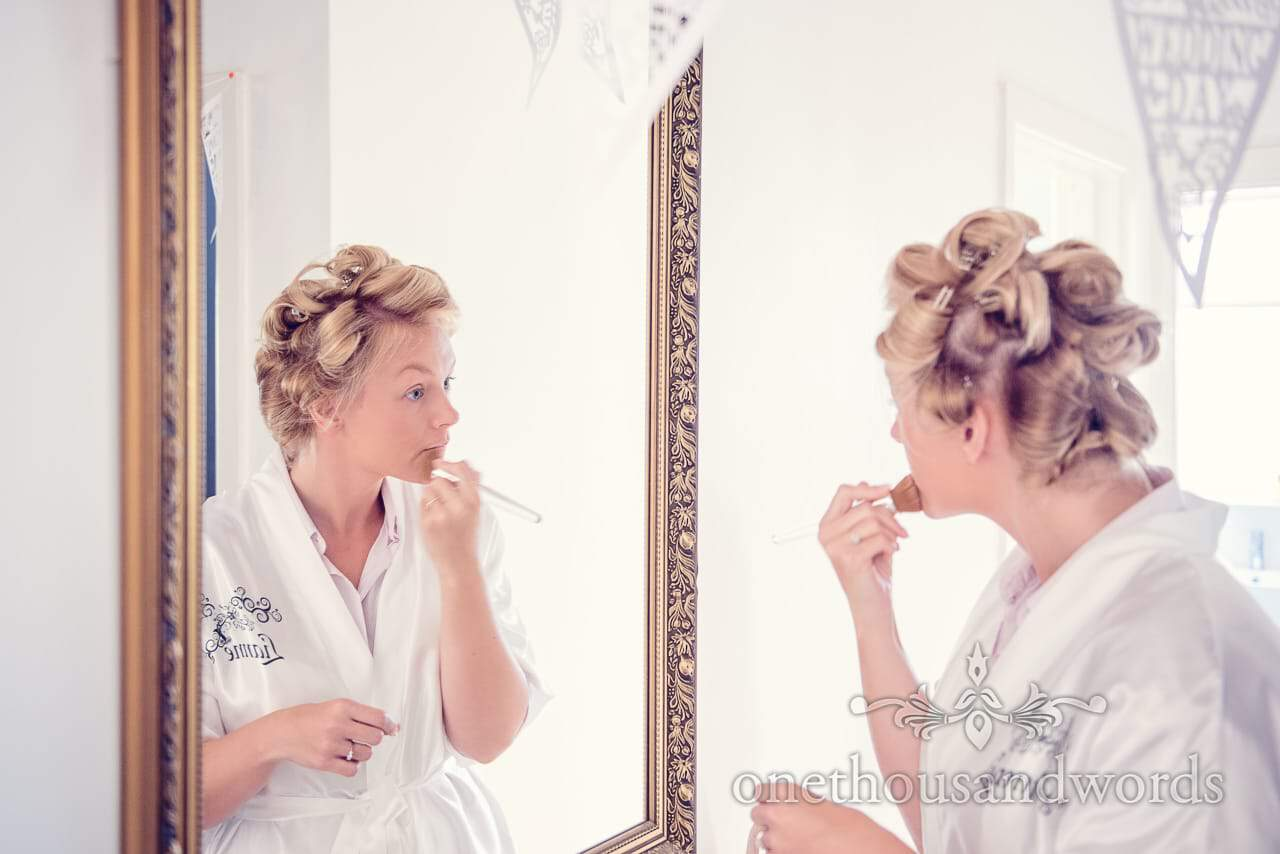 Bride does make up in mirror from Harbour Heights wedding