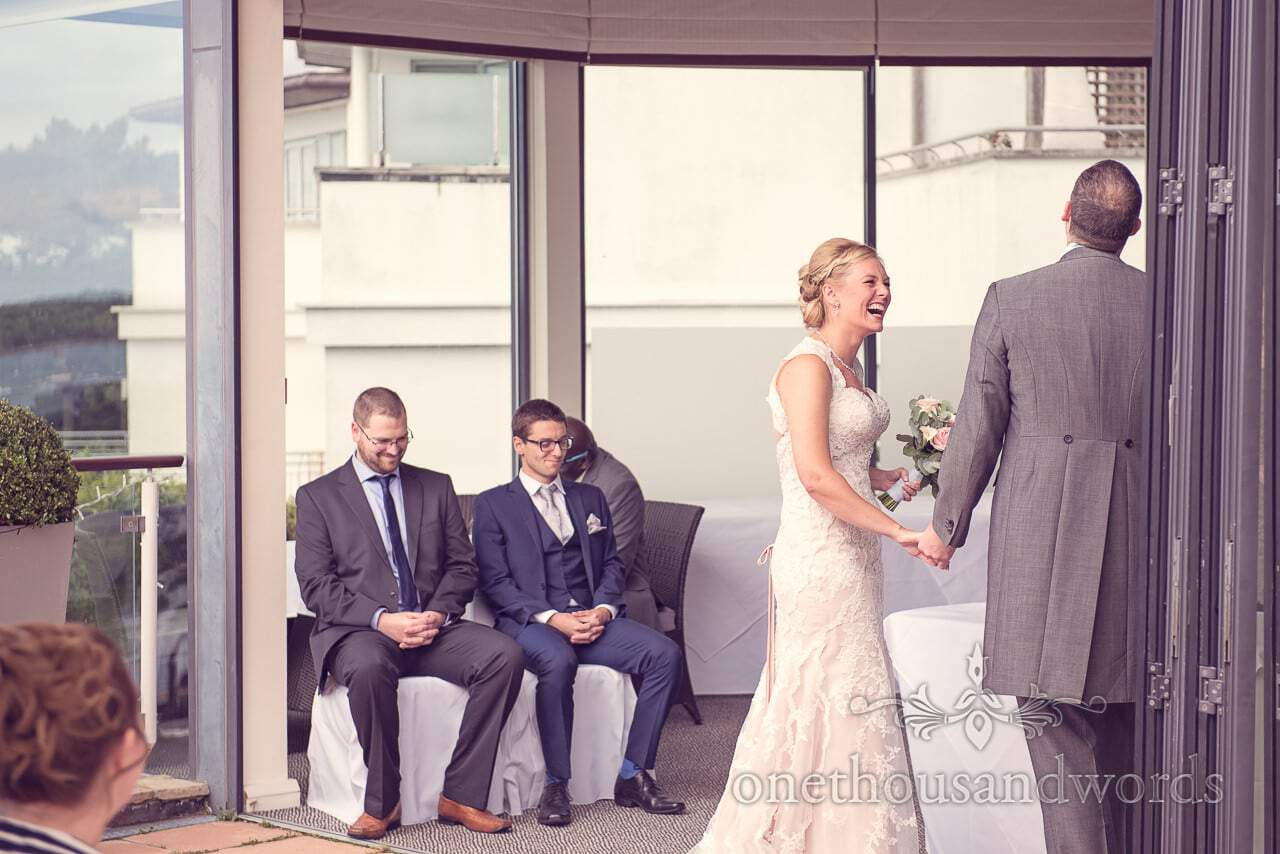 Bride laughs during ceremony at Harbour Heights Hotel outdoor wedding