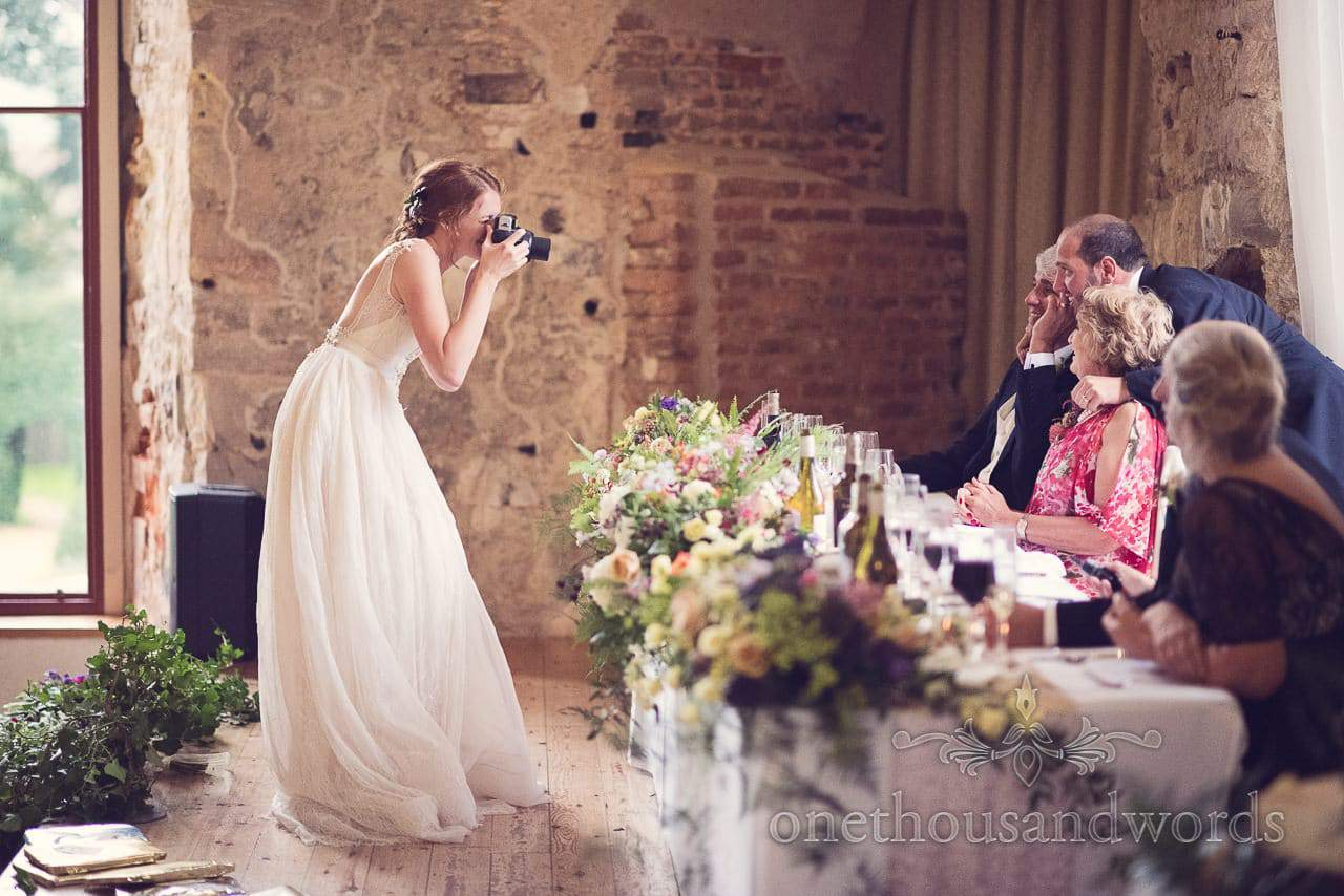 Bride take polaroid Dorset Castle wedding photographs of top table