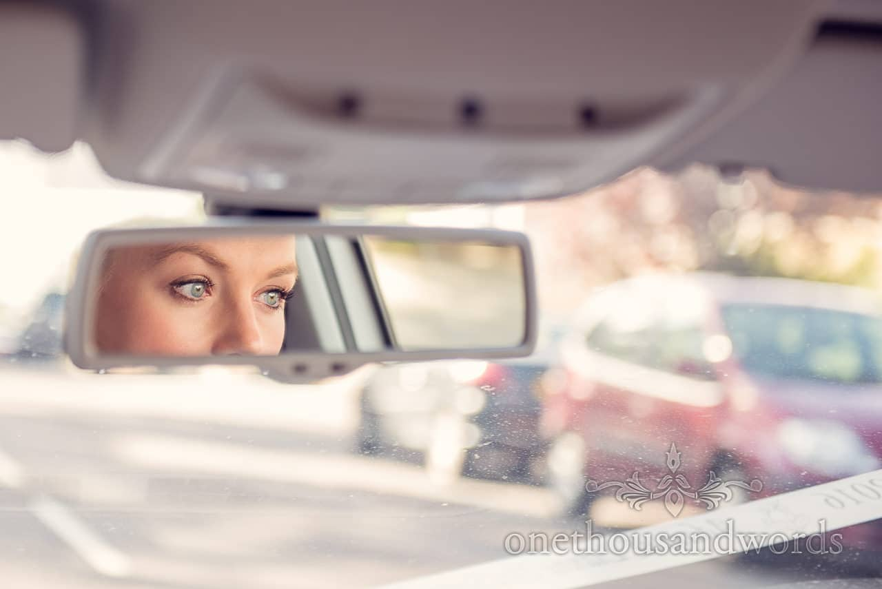 Brides eyes in car mirror on way to Harbour Heights wedding