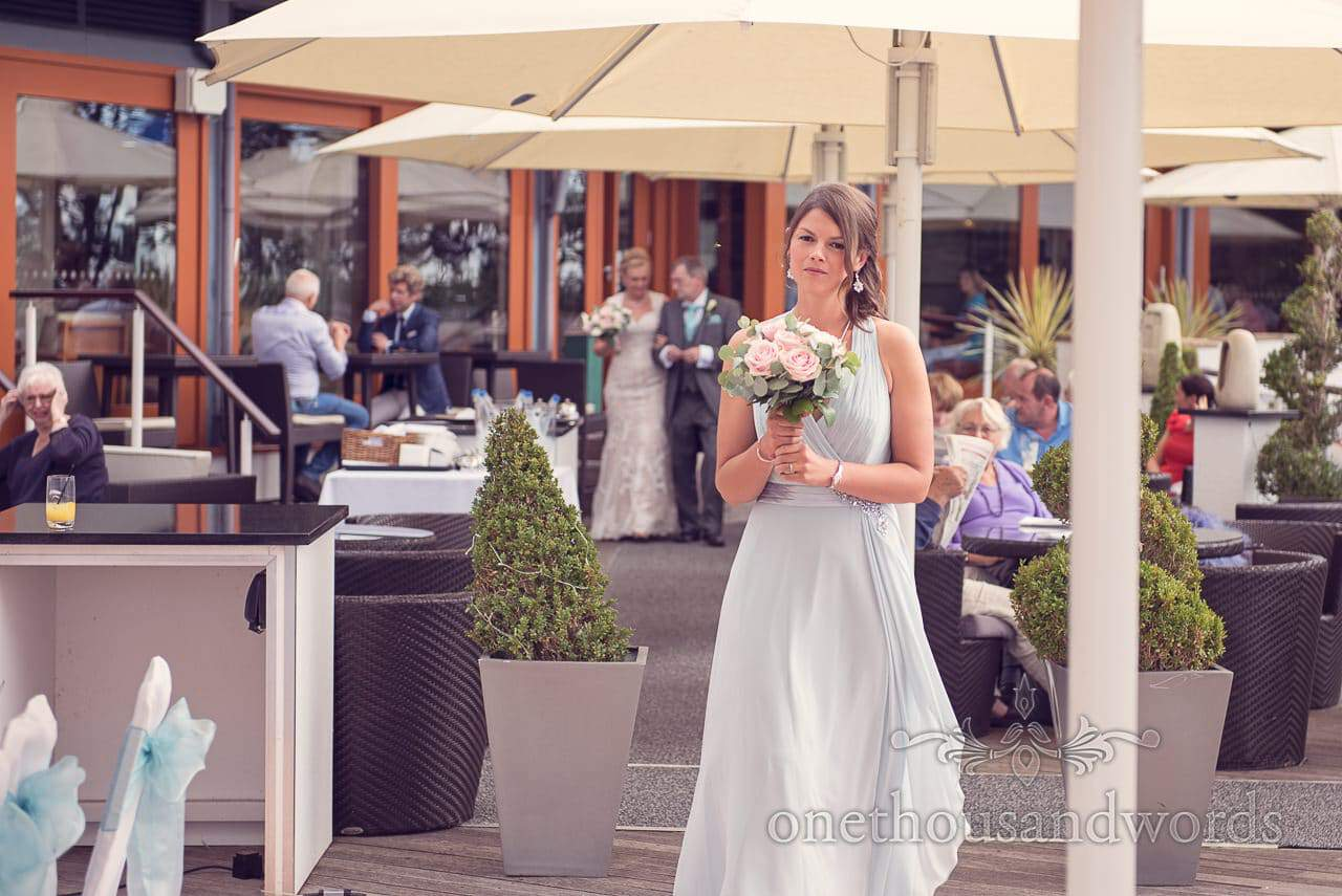 Bridesmaid at ceremony from Harbour Heights Hotel outdoor wedding