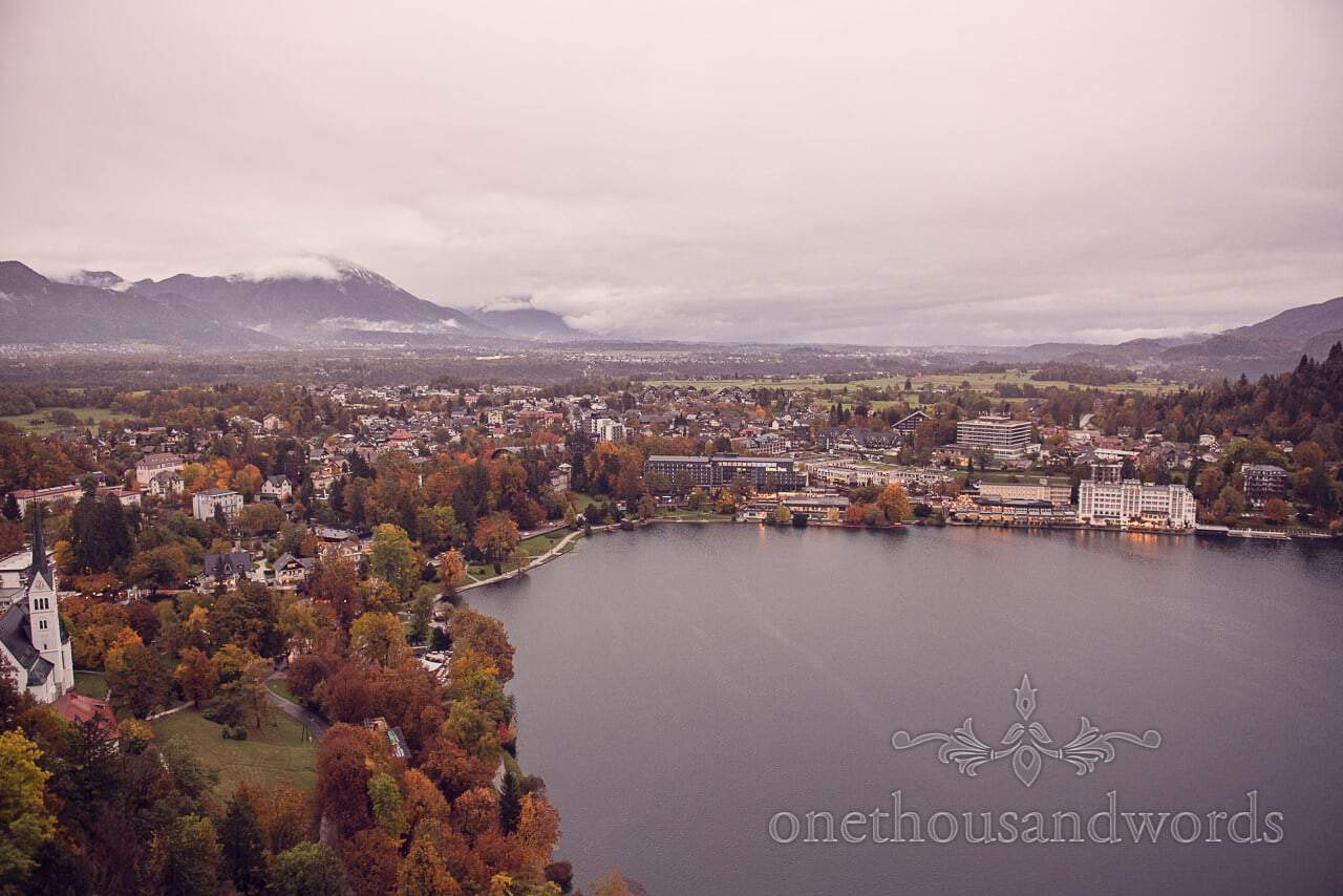 Destination wedding photographers capture Bled town from Bled Castle