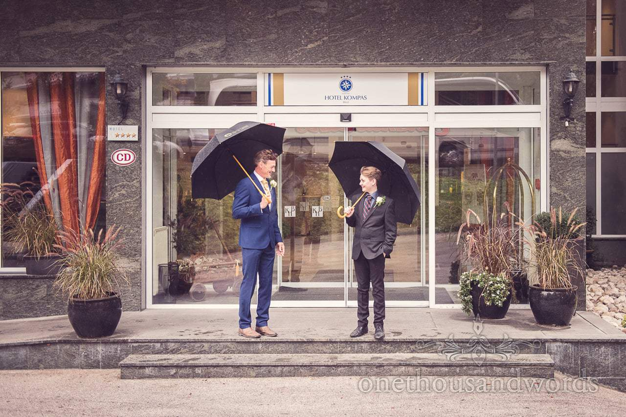 Destination wedding photographers capture groom and his son outside Hotel Kompass, Bled