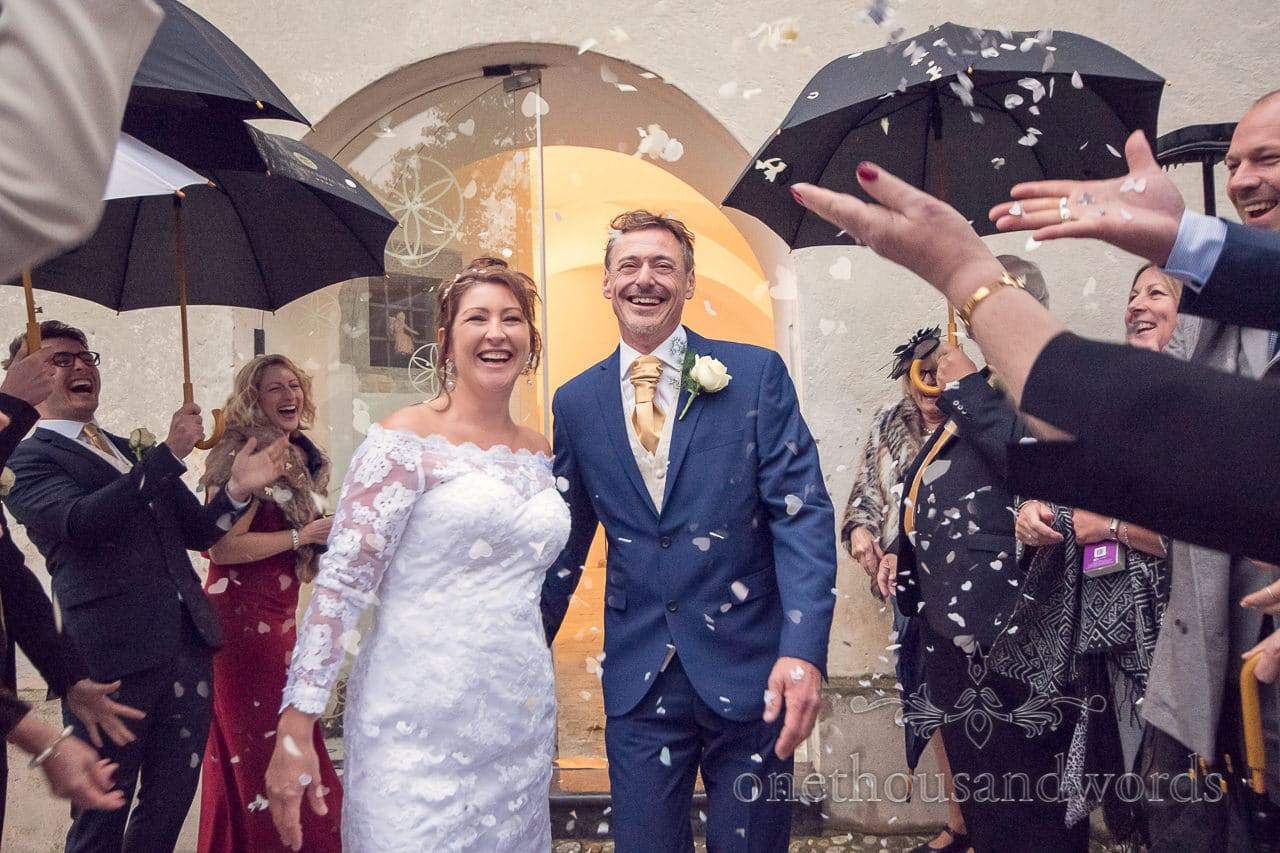 Destination wedding photographers capture wedding confetti outside Slovenian church