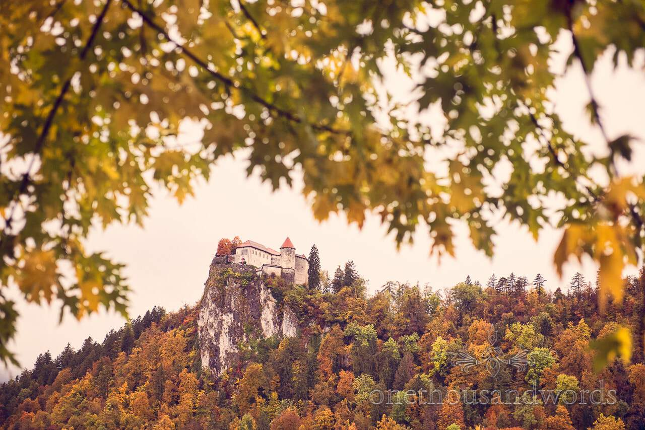 Destination wedding photographers photograph Bled Castle, Slovenia in the autumn