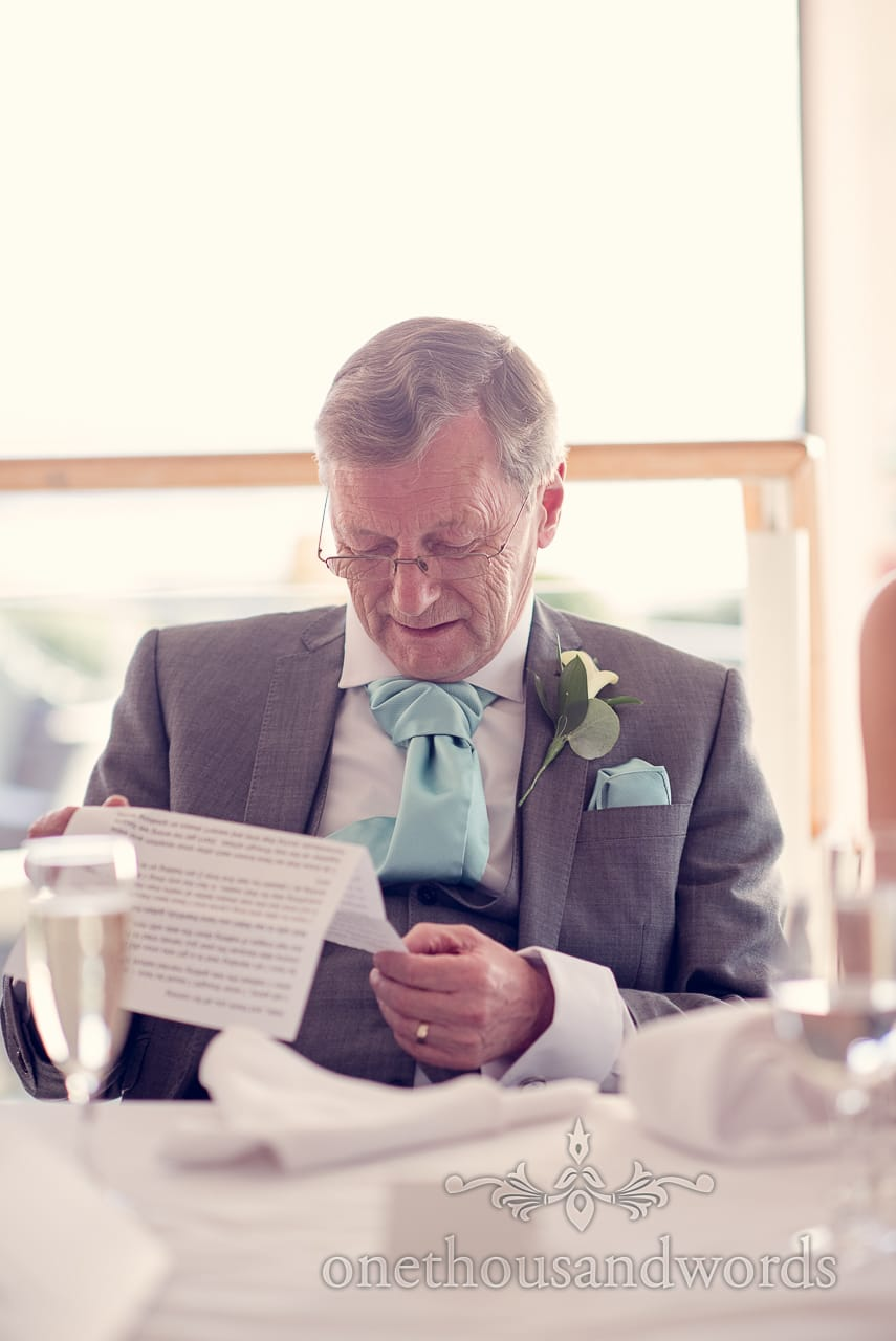 Father of the bride checks his speech at Harbour Heights wedding