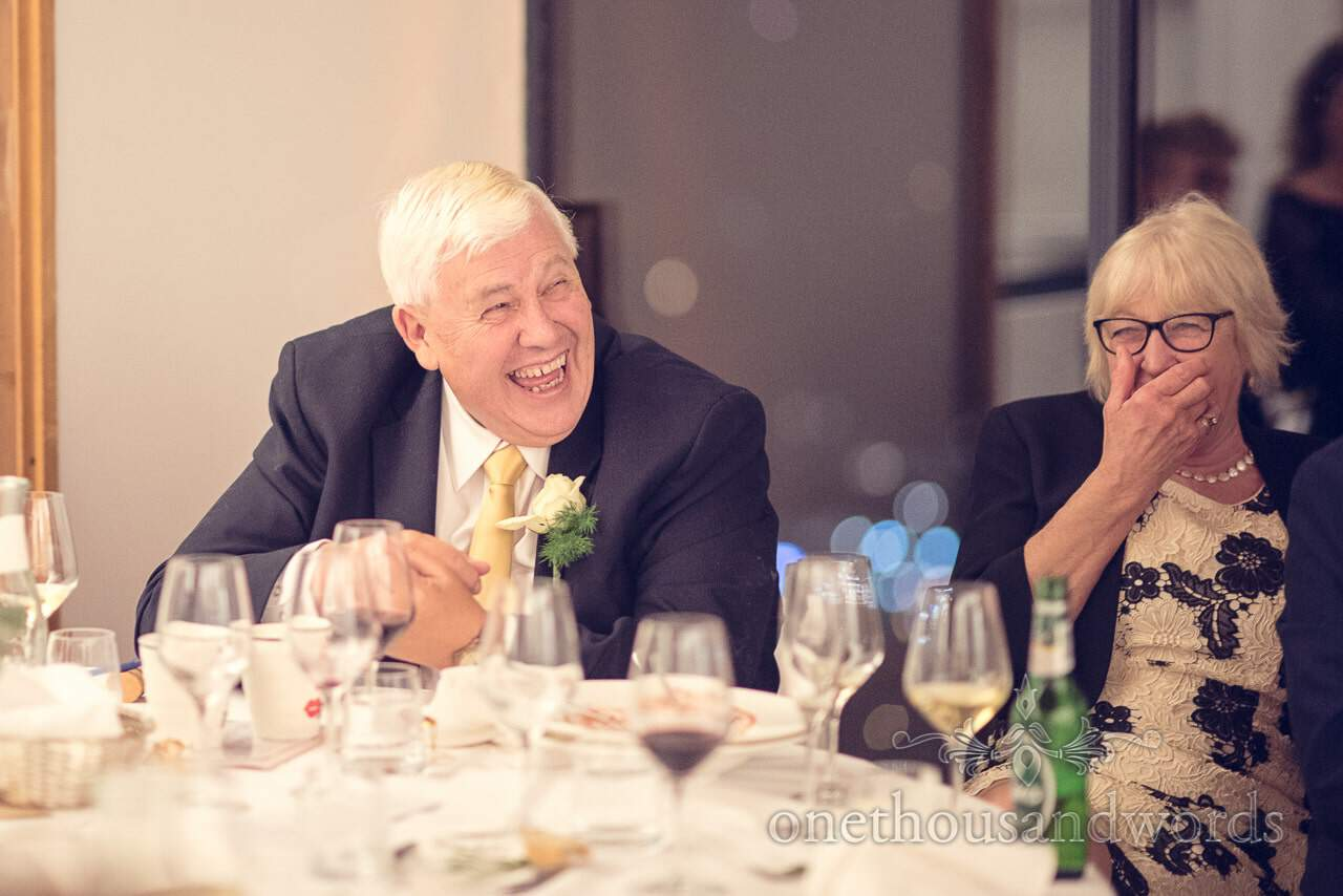 Father of the bride laughs at wedding speeches in Bled, Slovenia