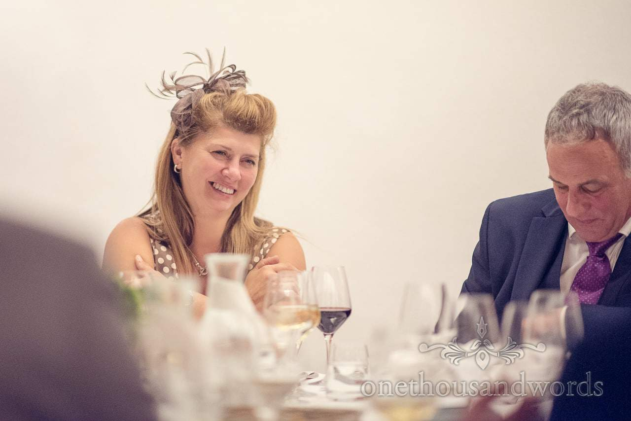 Female wedding guest in brown fascinator at Casle Bled wedding breakfast