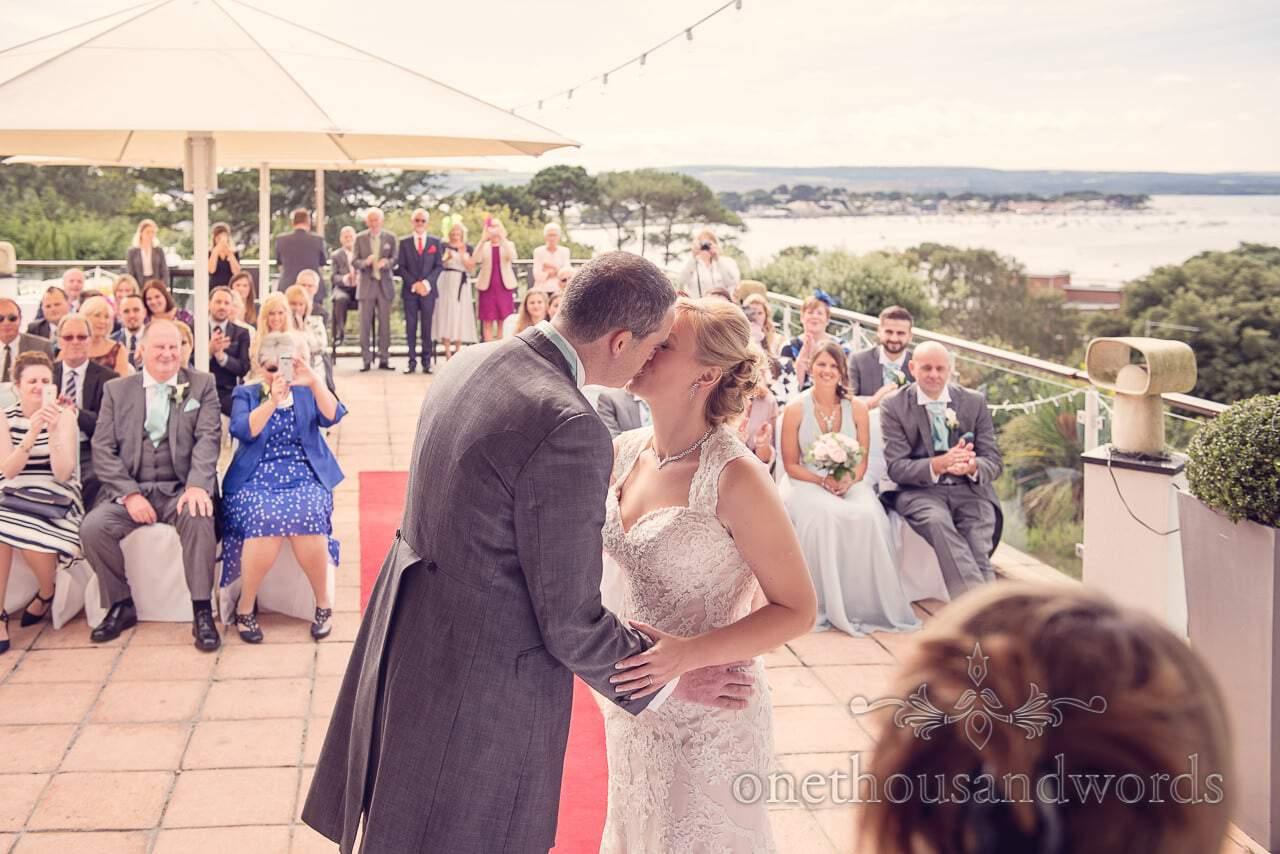 First kiss at Harbour Heights Hotel outdoor wedding