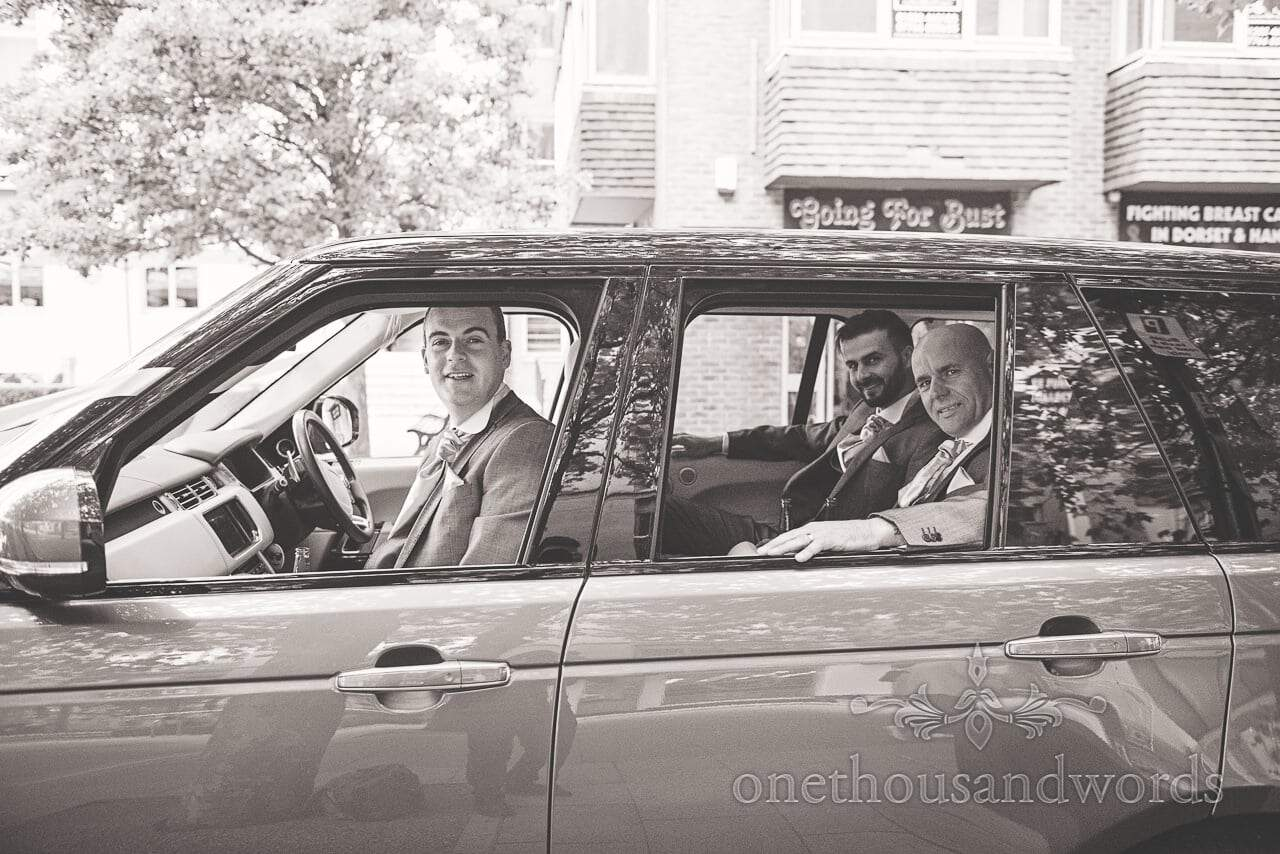 Groom and groomsmen in wedding car before Harbour Heights wedding