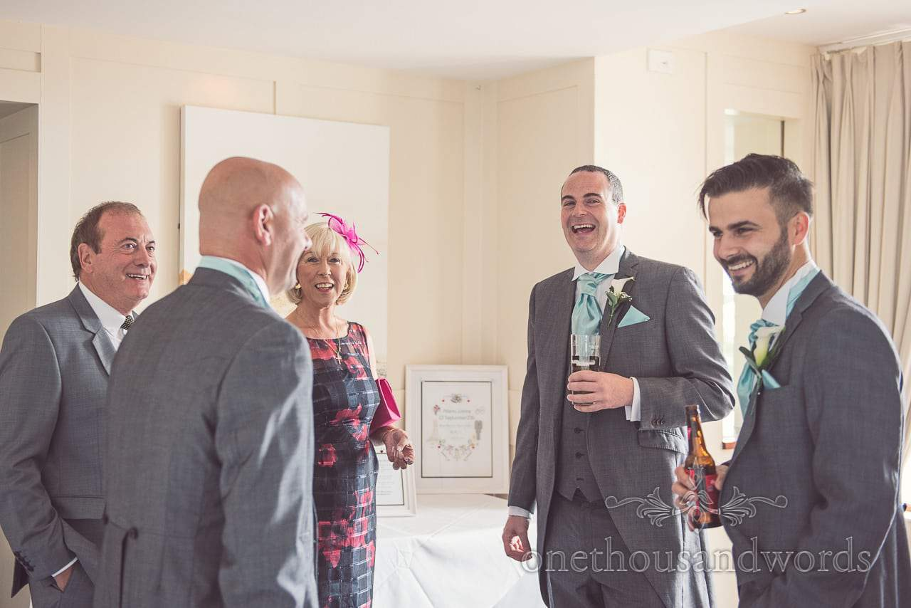 Groom and guests share a joke at Harbour Heights wedding