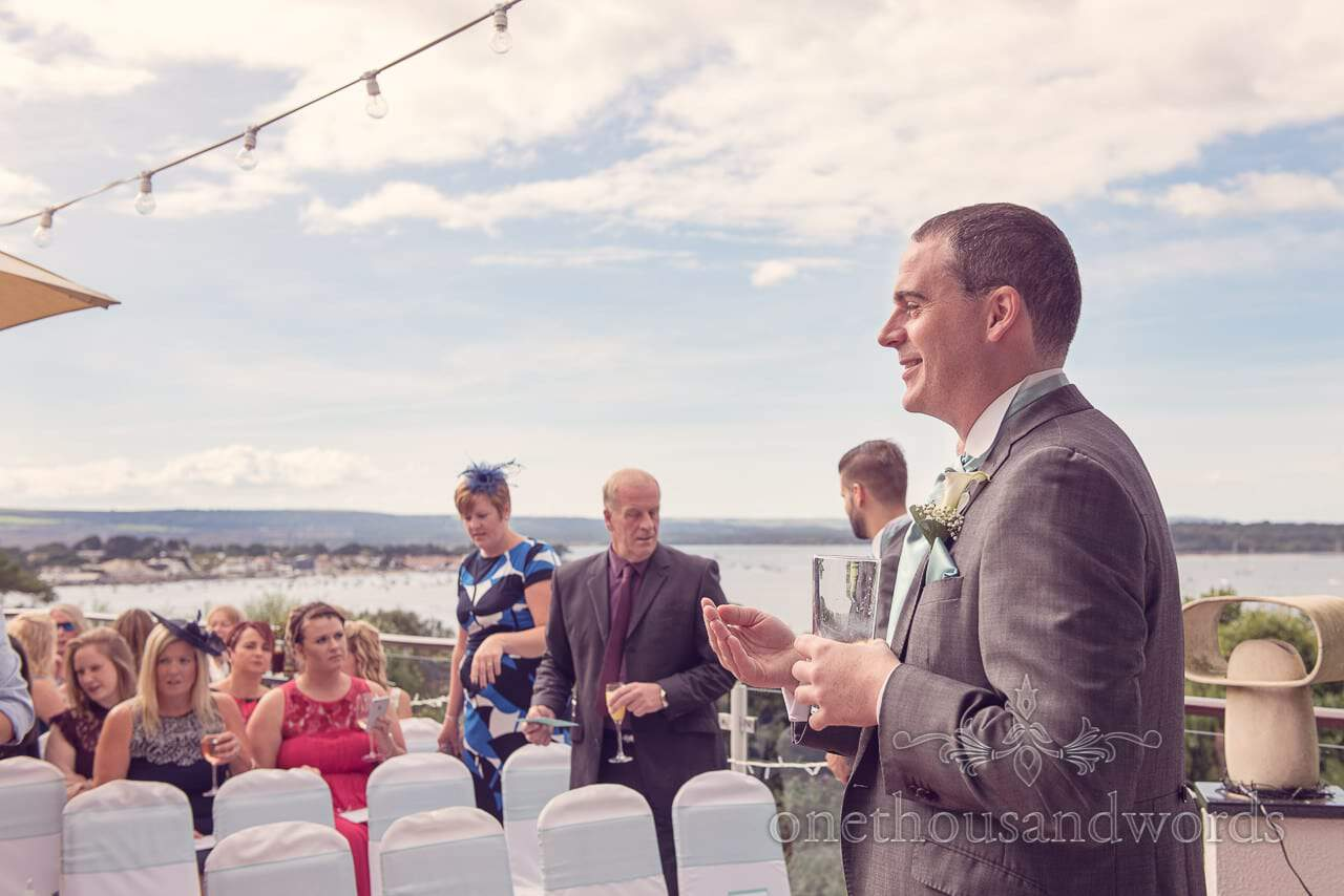 Groom before ceremony at Harbour Heights Hotel outdoor wedding